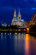 COLOGNE, GERMANY, 23 JULY 2020 Night view of Cologne Cathedral and Hohenzollern Bridge