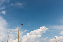 Lamp Posts And Blue Sky With Some Clouds