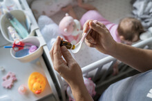 Father Preparing Spoon With Probiotic Drops Medicine For His Small Caucasian Baby Girl While Standing By The Cradle Crib At Home Close Up On Hands Selective Focus Copy Space Care And Parenting Concept