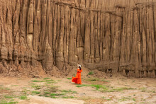 Women And Landscape Of Soil Textures Eroded Sandstone Pillars, Columns And Cliffs, Natural Erosion Of Water And Wind, Sao Din Na Noi, Hom Chom, Khok Suea At Sri Nan National Park In Nan Province