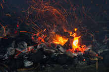 Sparks Of Fire Flying Above The Embers Of Tree Branches And Charcoal Prepared For A Fire Hazard Concept Barbecue.