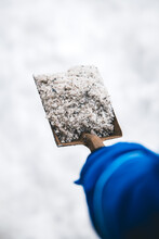Man Holding A Shovel With Road Or Thawing Salt, Safety Streets And Pathes