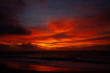 Bright Orange Sunrise Over Beach In Hawaii