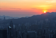 View Of High-rise Buildings At Sunset In Hong Kong