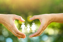 Family Paper Inside The Hand Man And Woman With Heart Sign In Public Park, Love Concept.