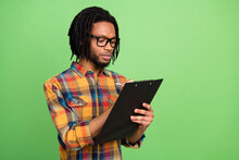 Profile Photo Of African Broker Guy Hold Clipboard Write Pen Wear Plaid Shirt Isolated Green Color Background