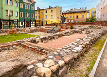 Ruins Of Medieval Saint Catherine Church And Vintage Tenement Houses In Bytow Historic City Center In Kaszuby Region Of Pomerania In Poland