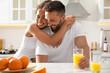 Leinwandbild Motiv Lovely couple enjoying time together during breakfast at table in kitchen