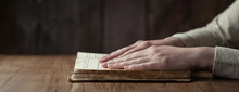 Woman Hands Praying With A Bible