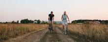 Couple Racing On Bikes