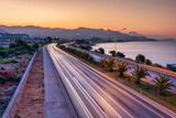 Fototapeta Bambus - Car lights on the Mediterranean coast highway in Alanya at dawn, Turkey