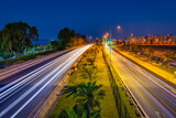 Fototapeta Bambus - Car lights on the Mediterranean coast highway in Alanya at night, Turkey