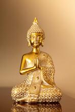 Golden Sitting Buddha Statuette