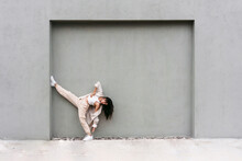 Graceful Dancer Performing Near Wall In City Street