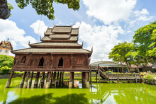 Beautiful Of Tripitaka Storage Tower.Thai Wooden Temple Architecture In The Middle Of The Pond At Wat Thung Si Muang In Ubon Ratchathani Province, Thailand, ASIA.