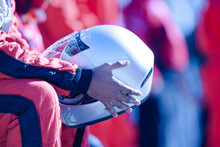 Close Up Racer Holding Helmet