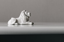 Toy Lion Figurine Made Of White Plaster For Painting With Paints