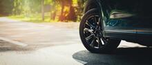 Sport Car With Black Alloy Wheels On Asphalt Road. Copy Space