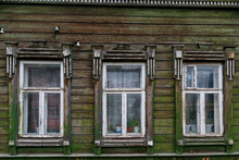 A Windows In The Wall Of An Old Wooden House