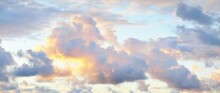 Clear Sky With Glowing Pink Cumulus Clouds Above The Baltic Sea Shore After Thunderstorm At Sunset. Dramatic Cloudscape. Soft Golden Sunlight. Picturesque Scenery. Fickle Weather, Nature, Climate