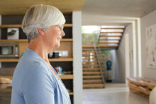Older Woman Posing In Modern House