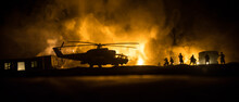 Silhouette Of Military Helicopter Ready To Fly From Conflict Zone. Decorated Night Footage With Helicopter Starting In Desert With Foggy Toned Backlit. Selective Focus. War Concept