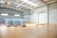 Pallets Of Water Bottles In Empty Warehouse
