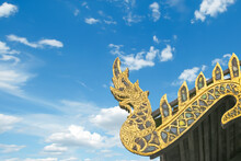Beautiful Old Golden Serpent Or Naga On Art Roof Of Buddhist Temple, Gable Of The Thai Northern Art Style, Buddhist Temple With Blue Sky In Temple Of Thailand