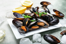 Plate With Raw Mussels On Table