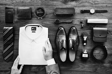 Flatlay View Of A Businessman Arranging His Belongings
