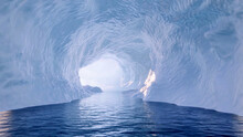 Scenic View Of Blue Water Surrounded By Ice Glaciers