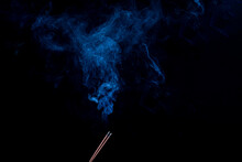 Black Background, Two Incense Sticks. There Is Smoke, Smell, Incense. Close-up.