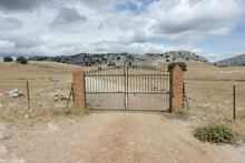 Landscape Of Metal Gate Through Ronda Road In Andalusia, Spain
