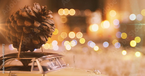 Image of pine cone on car model with glowing lights