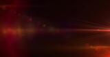 Red spots of light against black background