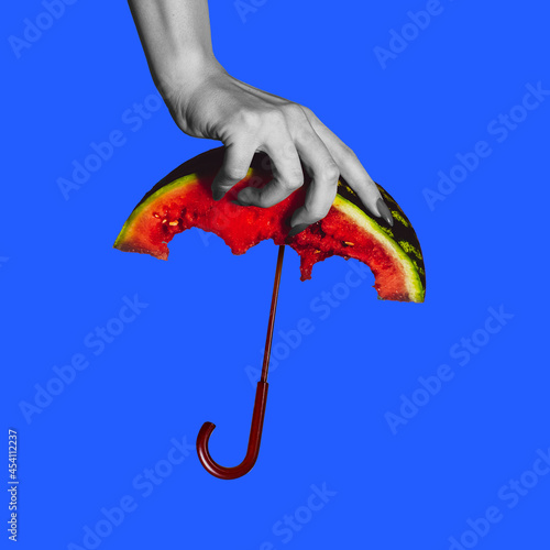 Modern design, contemporary art collage. Inspiration, idea, trendy urban magazine style. Female hand with water melon like umbrella on blue background