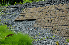 Gabion Large Retaining Wall, Basket Filled And Lined With Stone. It Is Filled With Coconut Jute Fabric To Filter Water And Be Anti-erosion At The Same Time. Geotextiles Under The Railway Tracks. Bank