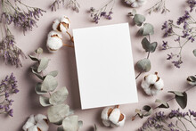 Invitation Or Greeting Card Mockup With Eucalyptus Twigs And Cotton Plant Flowers Decorations