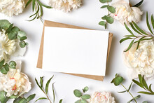 Invitation Or Greeting Card Mockup With Envelope And White Peony Flowers With Eucalyptus Twigs
