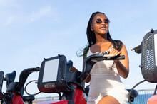 Black Woman Near Rental Bike In City