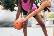 Active Diverse Women Playing Basketball On Playground