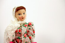 Portrait Of A Porcelain Doll. Doll In A White Shawl