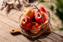 Delicious Fresh Apples In Basket On Cutting Board