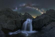 Waterfall Under Starry Sky With Milky Way