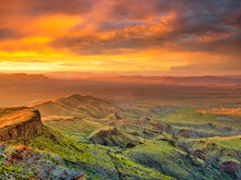 Unique Shot Of The Green Hills And Mountains During The Breathtaking Sunset.