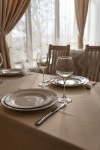 Beautifully Set Tables With Glasses And Plates In The Restaurant