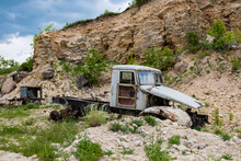 An Old Rusty Truck In An Abandoned Quarry.