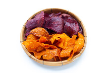 Purple And Yellow Sweet Potato Chips In Bamboo Basket On White Background.