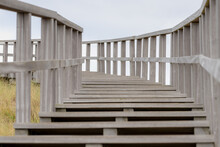 Structure And Curve Of Wooden Stairs And Rails With Selective Focus, Outdoor Wood Ladder To The Viewpoint, Petten Is A Town In The Dutch Province Of North Holland, Municipality Of Schagen, Netherlands