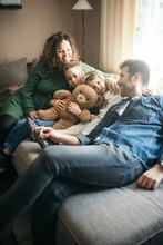 Happy Family With Teddy Bear Toy.